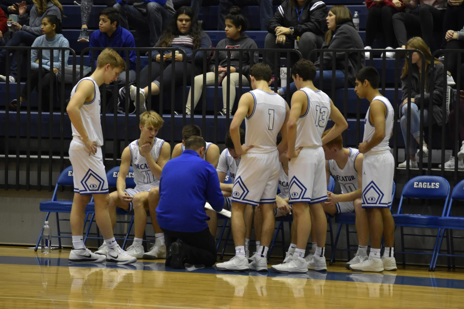 Pictured: Coach Drew Coffman advising his varsity basketball team  Photo courtesy of Lindsay Gogniat
