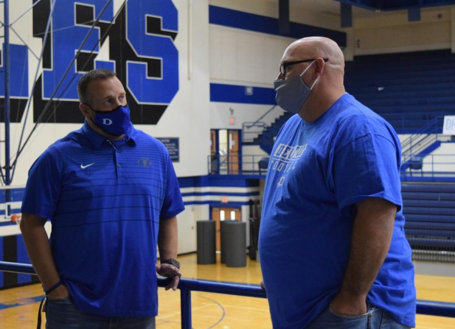 Associate Principal Brett Phipps catches up with Coach Kevin Thomas during the lunch rotation on September 11.