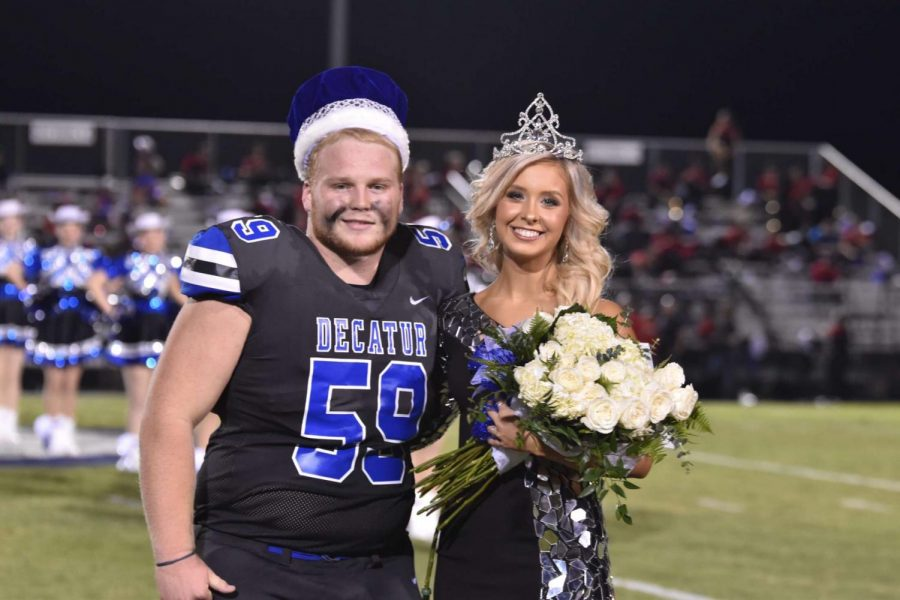 Homecoming King, Hayden Philpot, and Homecoming Queen, Libby Ragsdale, pose during half-time after being crowned.